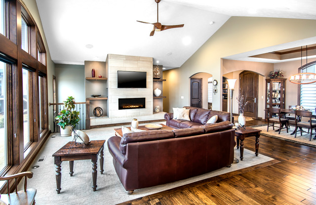 Example of a trendy open concept carpeted living room design in Other with a ribbon fireplace, a tile fireplace, a wall-mounted tv and beige walls