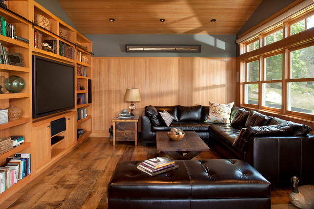 Traditional Medium Tone Wood Floor Living Room Idea In Vancouver With A  Media Wall