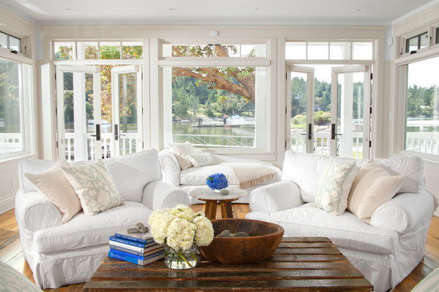 Example of a coastal medium tone wood floor living room design in Vancouver