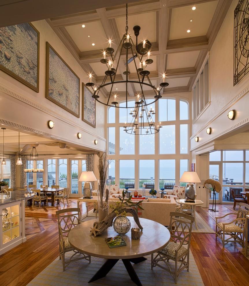Inspiration for a huge coastal open concept medium tone wood floor living room remodel in Philadelphia with beige walls and no tv