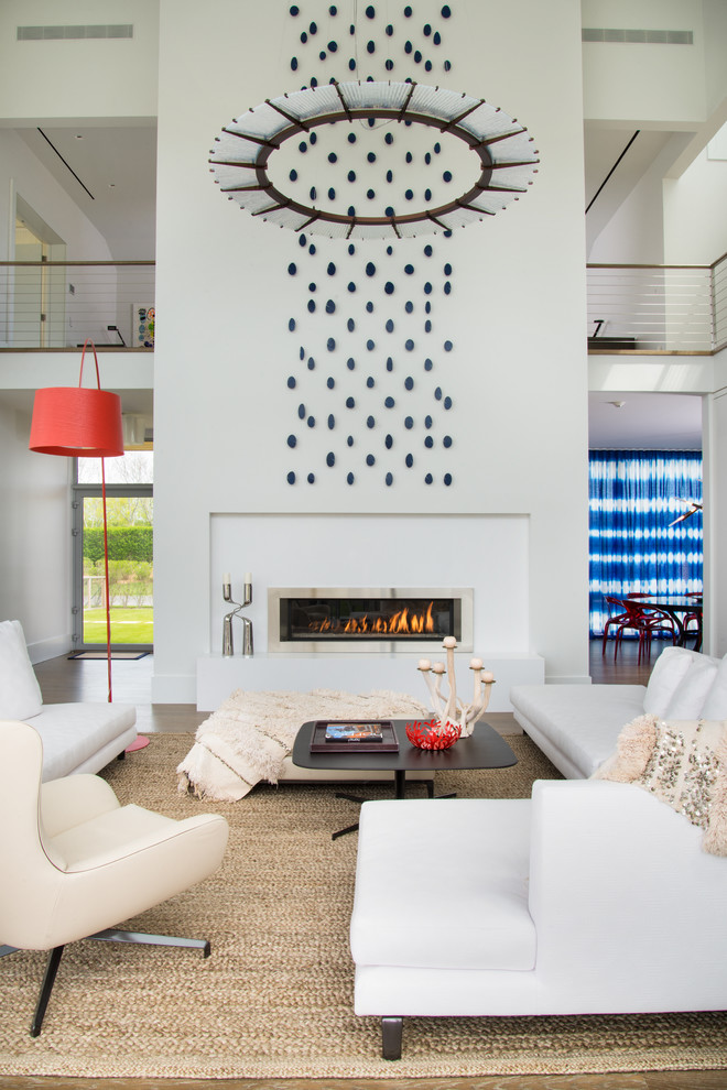 Living room - large contemporary formal living room idea in New York with white walls and a ribbon fireplace