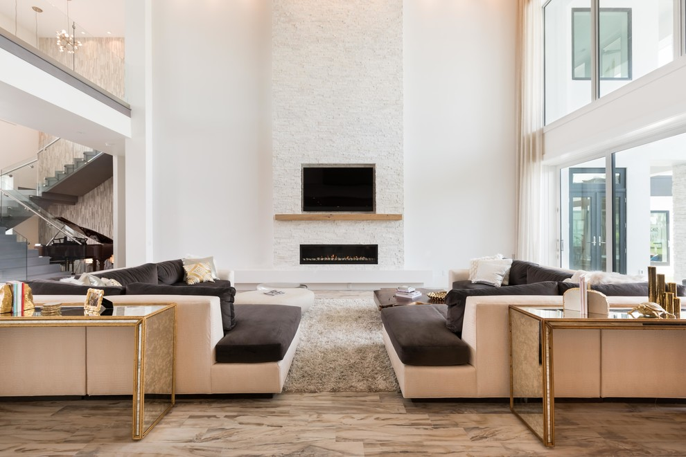Example of a huge trendy formal and open concept living room design in Orlando with a ribbon fireplace, a stone fireplace and a media wall