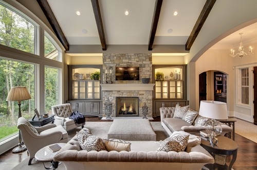 Classic living room with vaulted ceilings and exposed wooden beams.