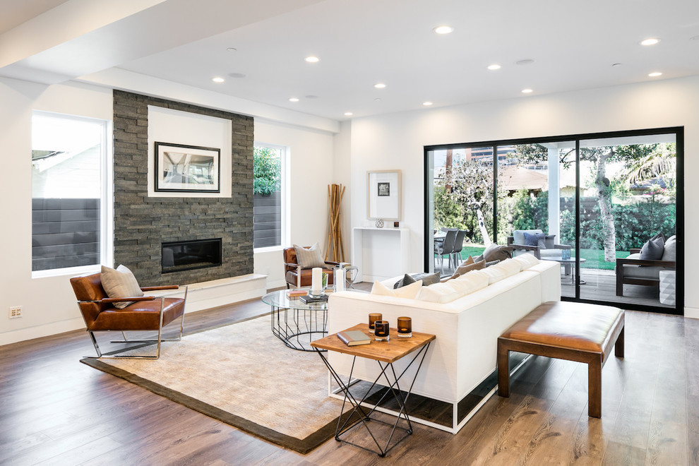 Living room - contemporary open concept light wood floor living room idea in Los Angeles with white walls, a ribbon fireplace and a stone fireplace