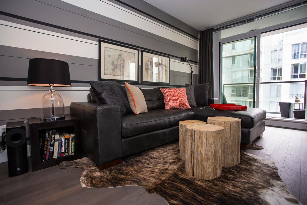 Esempio di un soggiorno design con pareti grigie