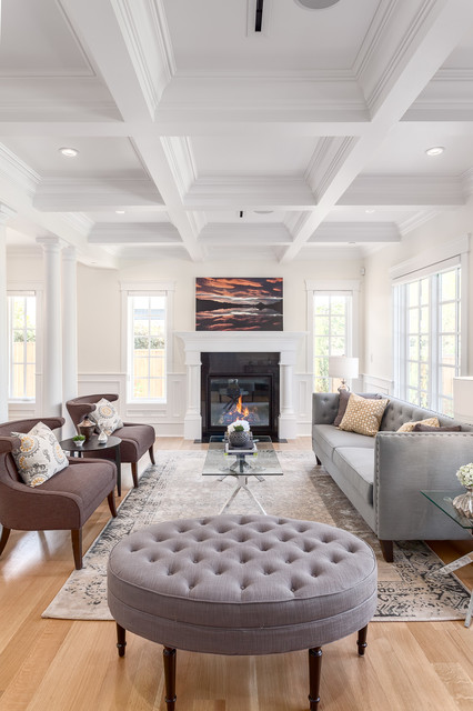 Inspiration for a large transitional open concept and formal medium tone wood floor living room remodel in Vancouver with white walls, a standard fireplace, a stone fireplace and no tv