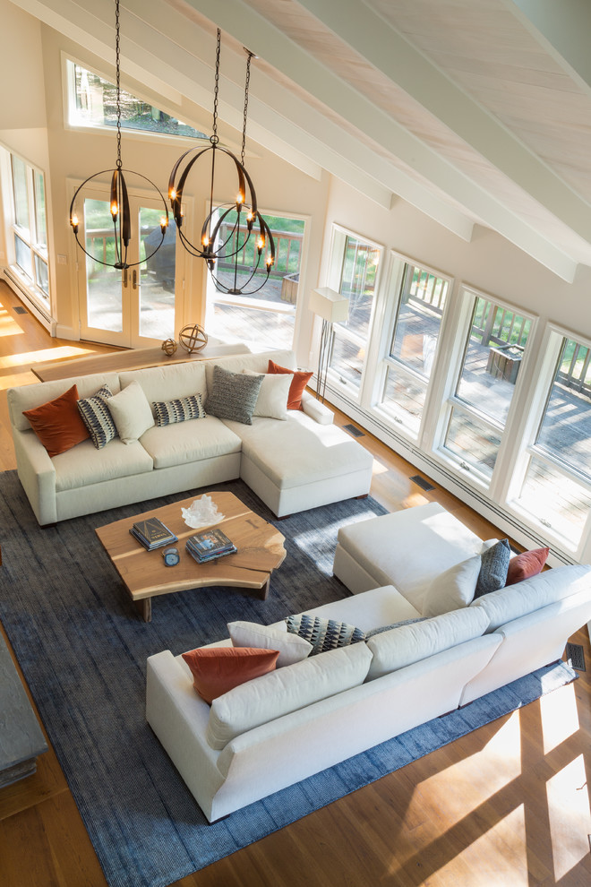 Inspiration for a large contemporary open concept medium tone wood floor and brown floor living room remodel in Salt Lake City with no tv, gray walls, a standard fireplace and a stone fireplace