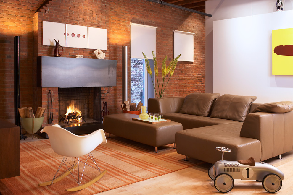 Example of a mid-sized urban light wood floor living room design in New York with white walls, a standard fireplace and a brick fireplace