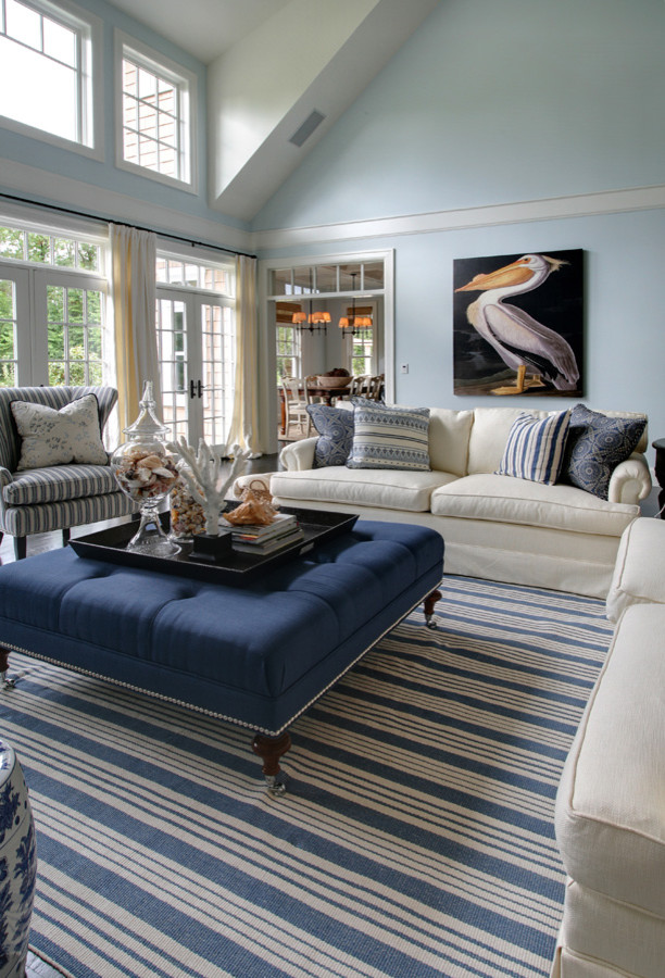 Inspiration for a large beach style enclosed dark wood floor living room remodel in Portland with blue walls