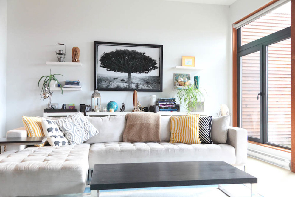 Living room - coastal living room idea in Vancouver with white walls