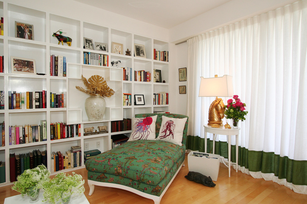 Living room library - contemporary living room library idea in Los Angeles with white walls