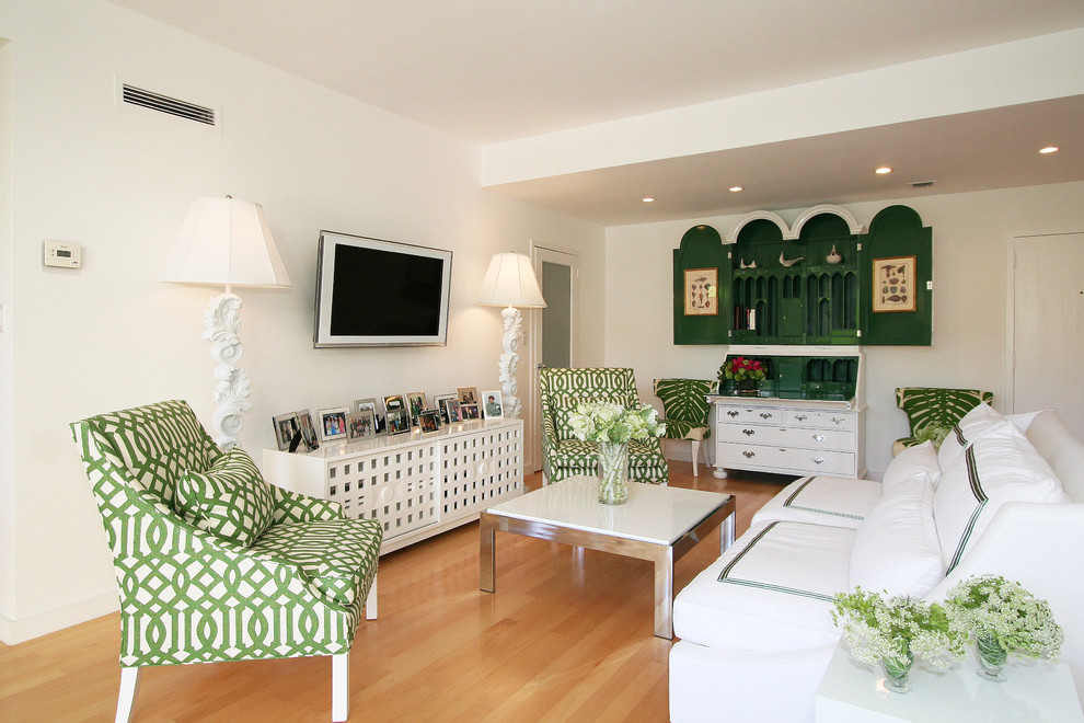 Example of a trendy enclosed living room design in Los Angeles with a wall-mounted tv