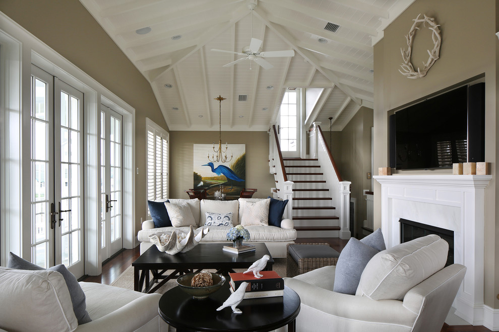 Island style formal and enclosed living room photo in Tampa with a standard fireplace and a wall-mounted tv