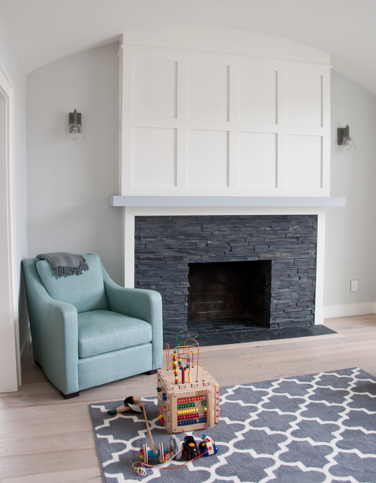 Example of a mid-sized trendy open concept light wood floor living room design in San Francisco with gray walls, a standard fireplace, a stone fireplace and no tv