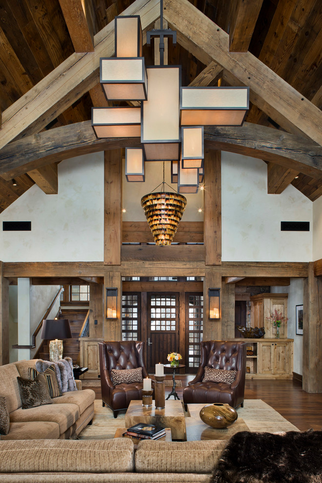 Inspiration for a rustic open concept dark wood floor living room remodel in Other