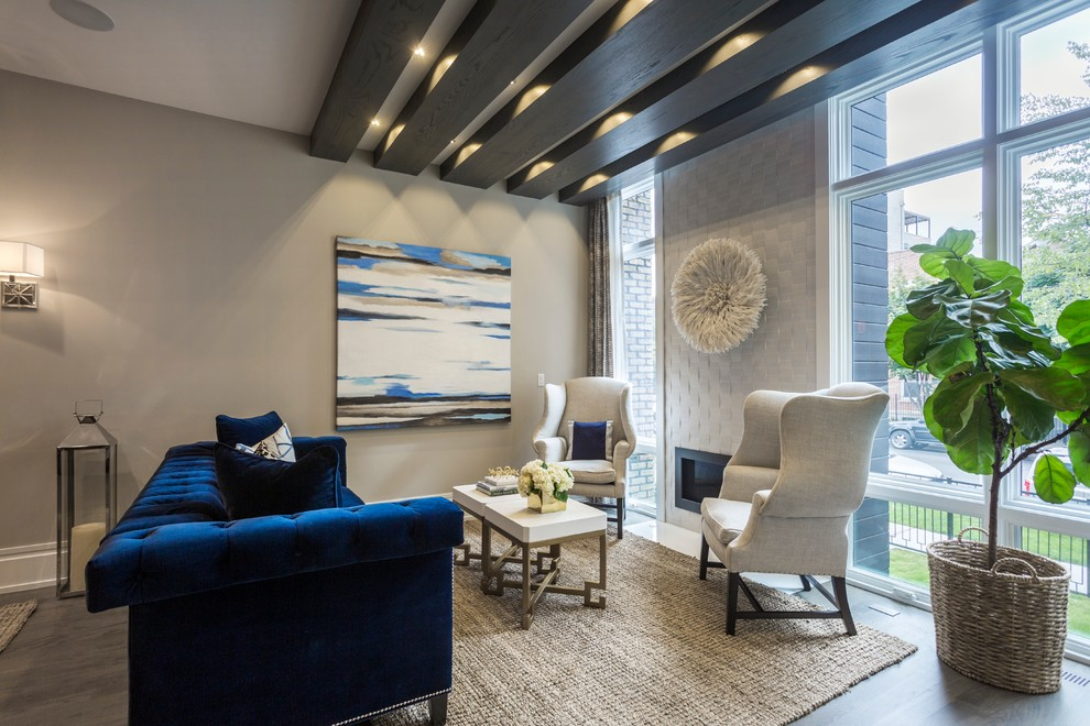 Inspiration for a transitional light wood floor living room remodel in Chicago with gray walls, a ribbon fireplace and no tv