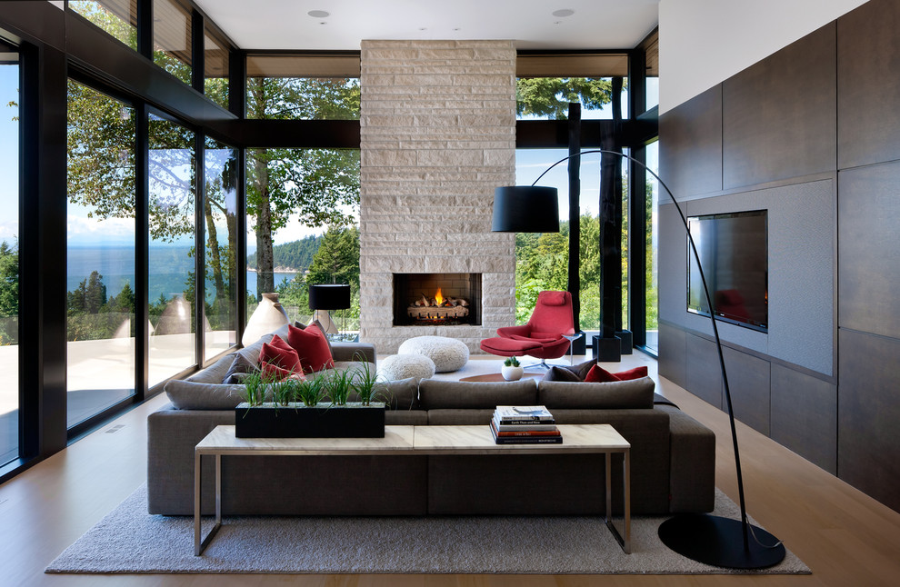 Inspiration for a large modern open concept beige floor and medium tone wood floor living room remodel in Vancouver with a media wall, a standard fireplace and a stone fireplace