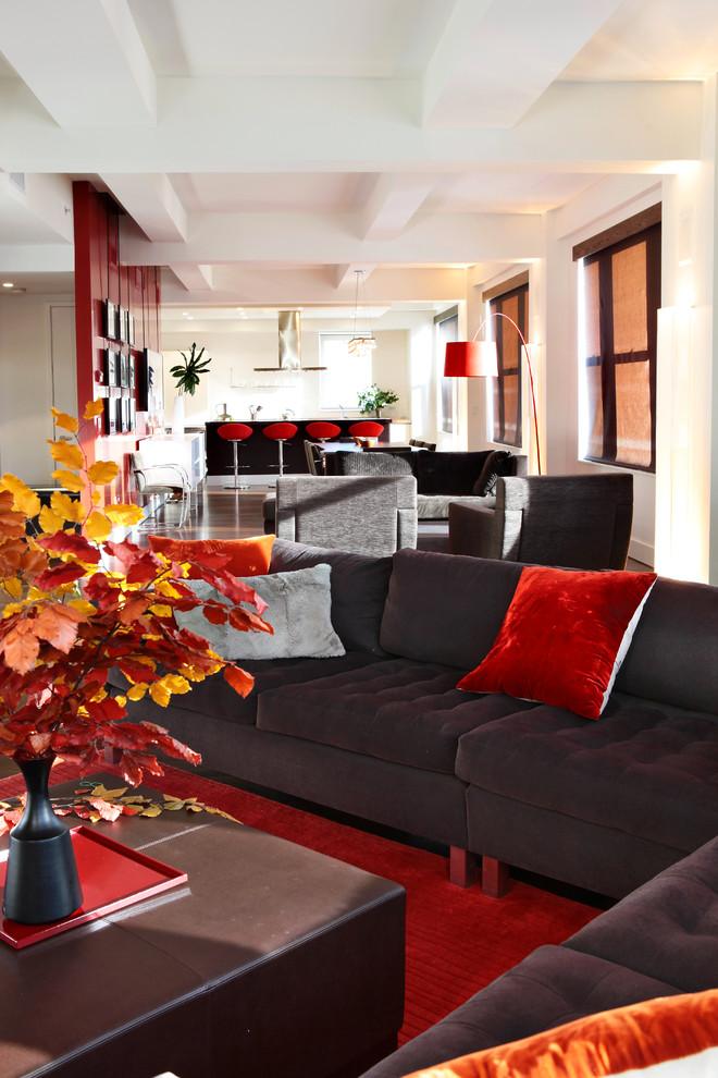 Living room - modern open concept red floor living room idea in New York