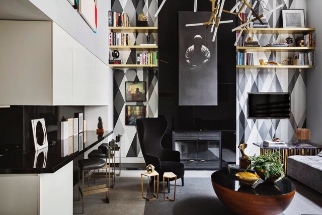 Inspiration for a mid-sized modern loft-style dark wood floor and gray floor living room library remodel in New York with gray walls, a standard fireplace, a metal fireplace and a concealed tv