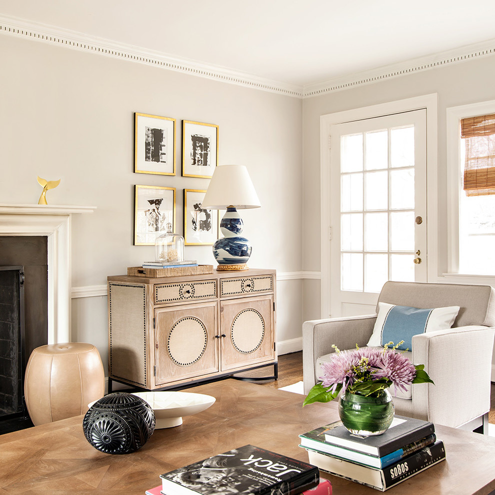Inspiration for a transitional dark wood floor living room remodel in New York with gray walls and a standard fireplace