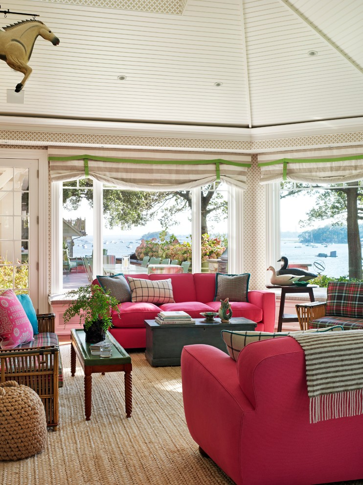 Example of a coastal living room design in New York with multicolored walls