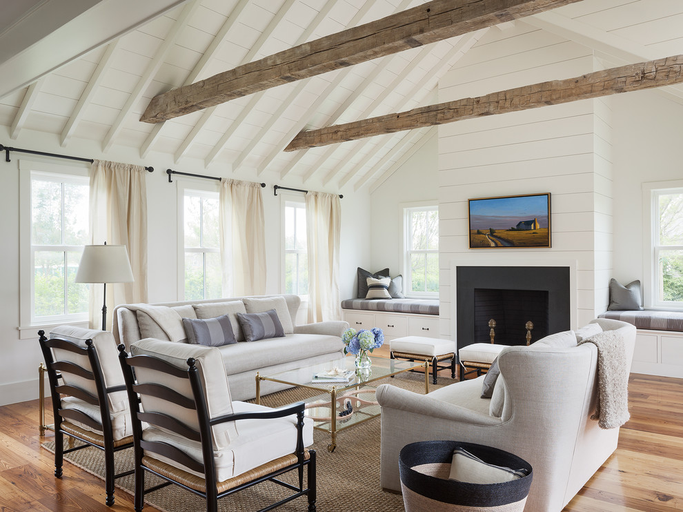 Inspiration for a country living room remodel in Boston with white walls