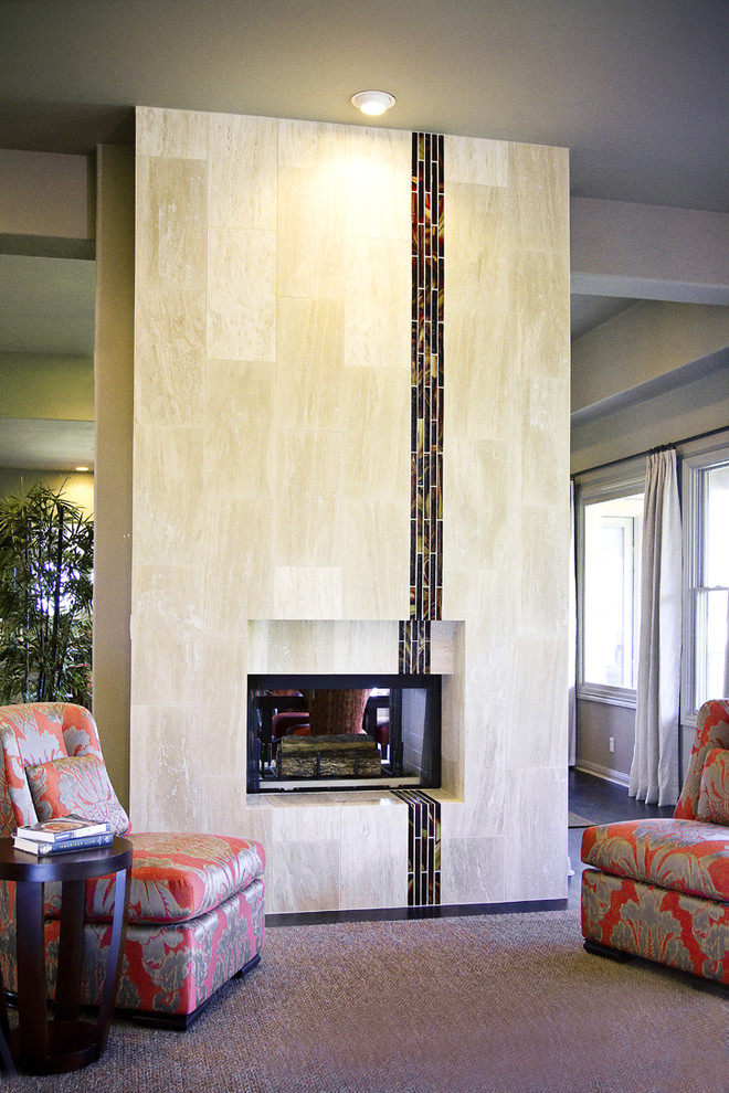 Living room - contemporary living room idea in Austin with a two-sided fireplace