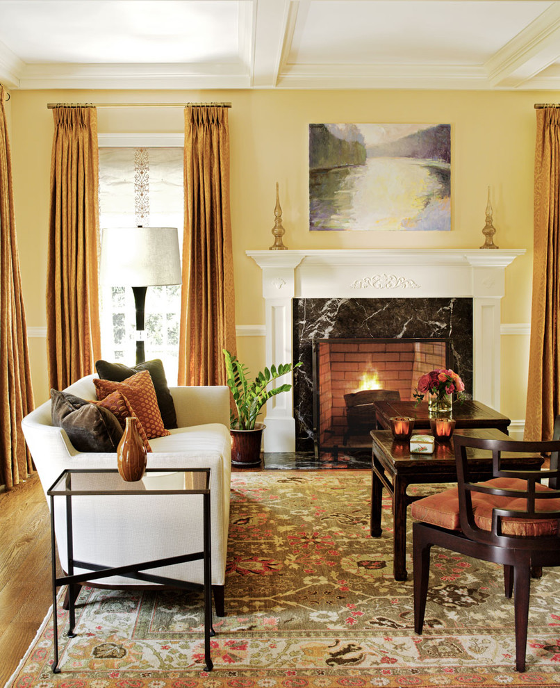 Living room - traditional formal living room idea in New York with yellow walls, a standard fireplace and no tv