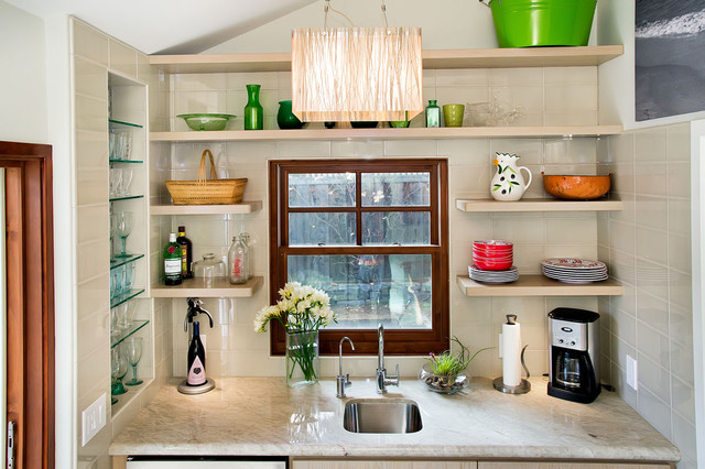 Wet Bar with tiled niche for glassware and floating shelves eclectic living room