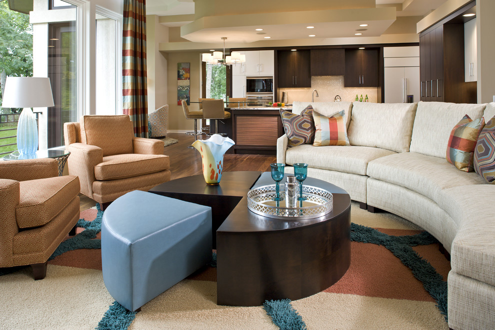 Example of a trendy open concept living room design in Minneapolis with beige walls