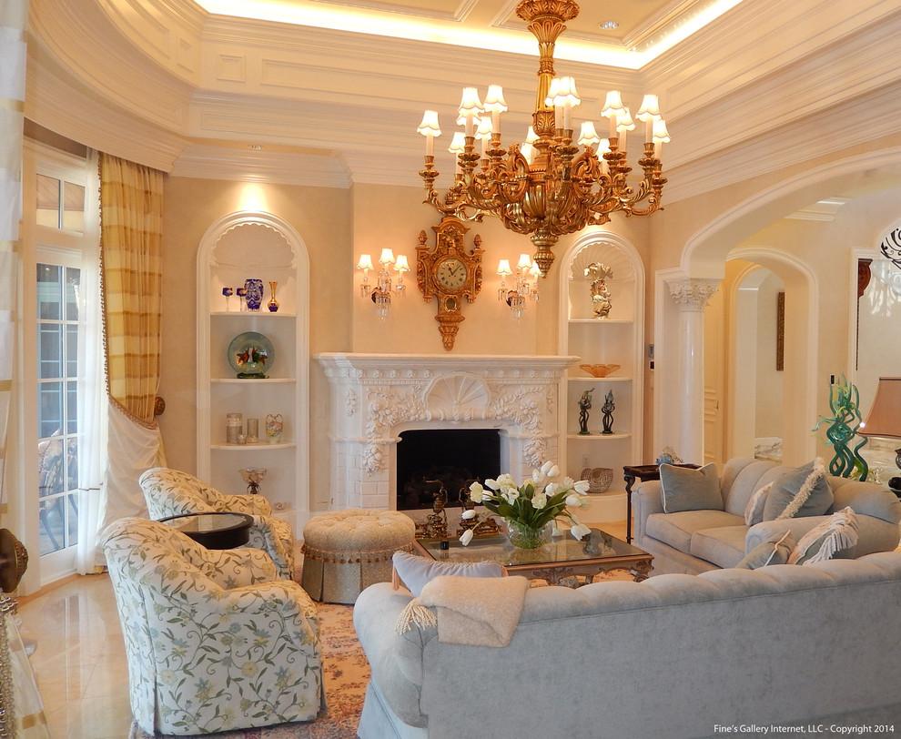 マイアミの広い地中海スタイルのリビング・居間の画像 (ベージュの壁、大理石の床、両方向型暖炉、石材の暖炉まわり)