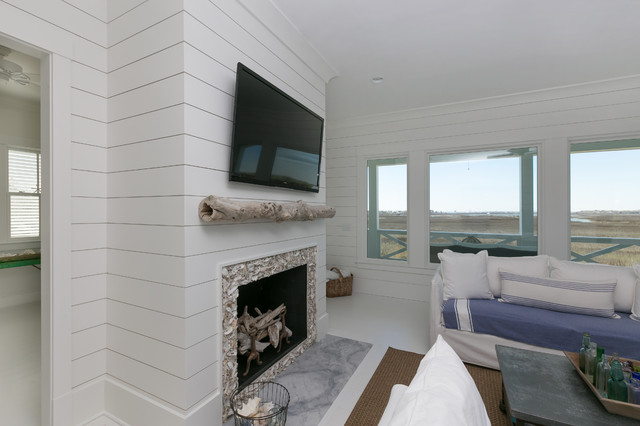 White Island Living Room With Wooden Shiplap Walls Fireplace Beach Style