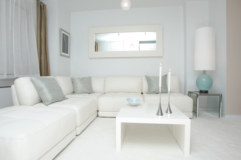 Trendy living room photo in New York with blue walls