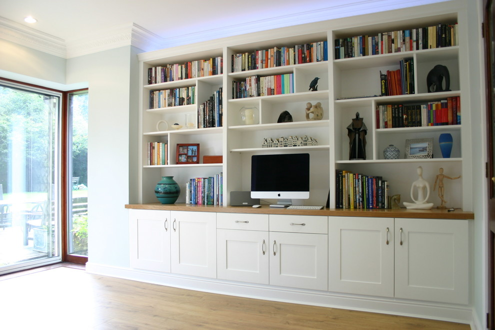 White painted wall shelving with oak top