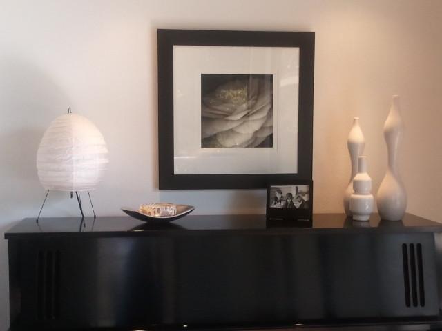 white still life on black piano midcentury-living-room