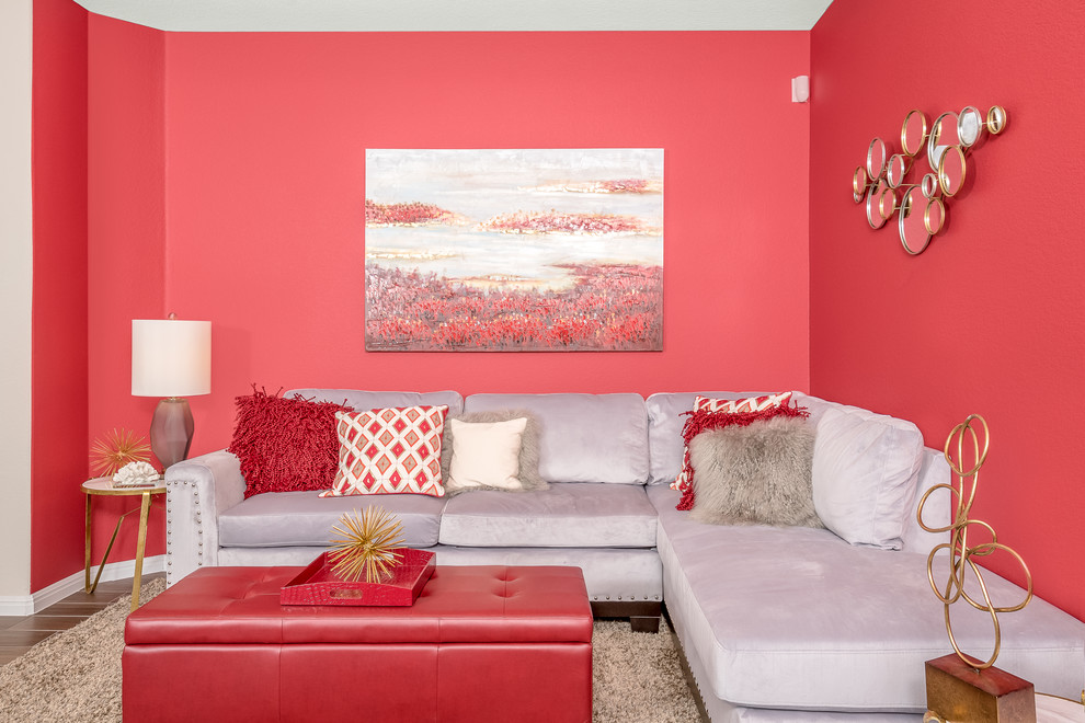 Inspiration for a mid-sized contemporary formal and enclosed porcelain tile living room remodel in Austin with red walls, no fireplace and no tv