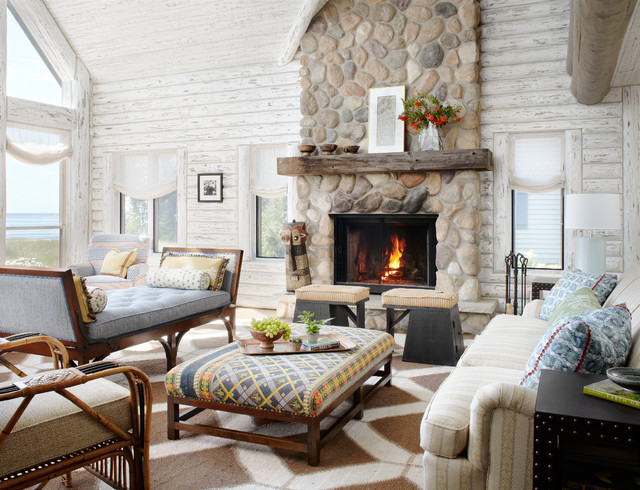 Mountain Style Living Room Photo In Milwaukee With A Standard Fireplace And Stone