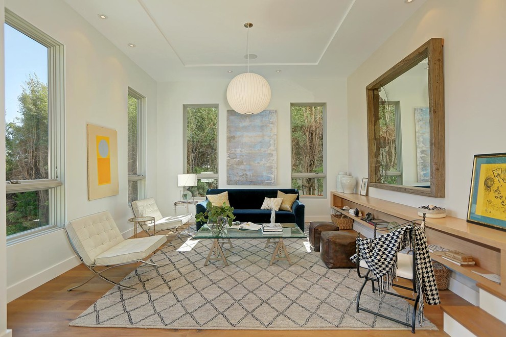Large minimalist formal and enclosed light wood floor living room photo in Los Angeles with beige walls and no tv