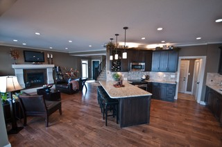 Great room includes kitchen with diagonal dining counter.