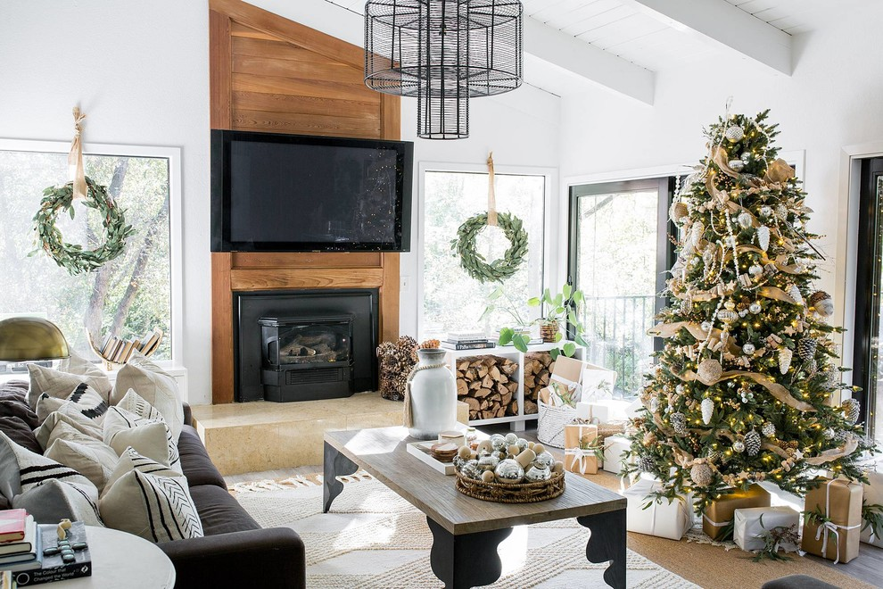 Inspiration for a farmhouse dark wood floor and brown floor living room remodel in Sacramento with white walls, a wood stove and a wall-mounted tv
