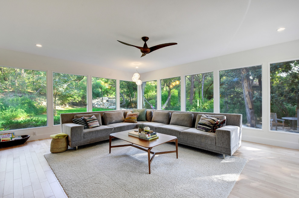 Living room - large 1960s open concept and formal light wood floor living room idea in Austin with white walls, no fireplace and no tv