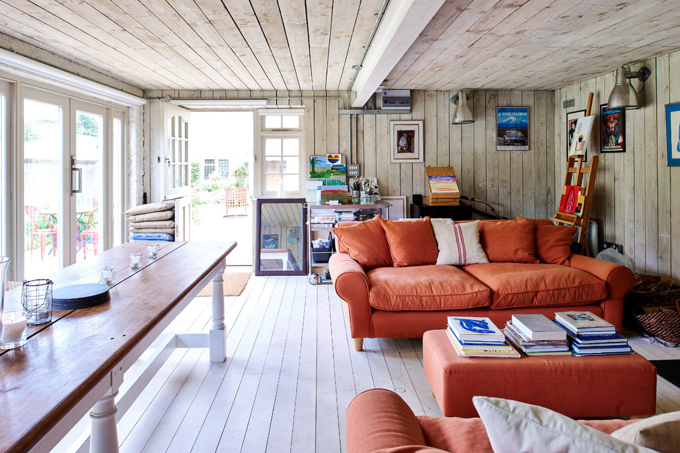 Farmhouse formal and enclosed painted wood floor and white floor living room photo in London with beige walls