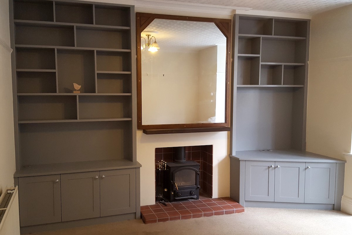 Wide Alcove Cabinets in Grey with Asymmetrical Shelving and Angled Cabinets