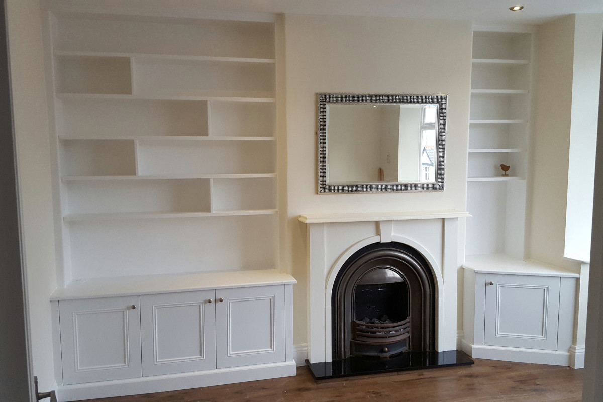 Wide and Narrow Classic Alcoves in White with an Angled Cupboard