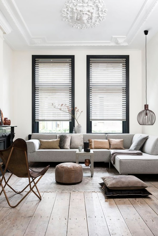 Mid-sized danish open concept light wood floor and beige floor living room photo in Melbourne with white walls