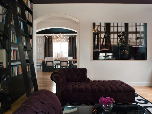 A Gothic-inspired living room featuring a burgundy velvet chaise