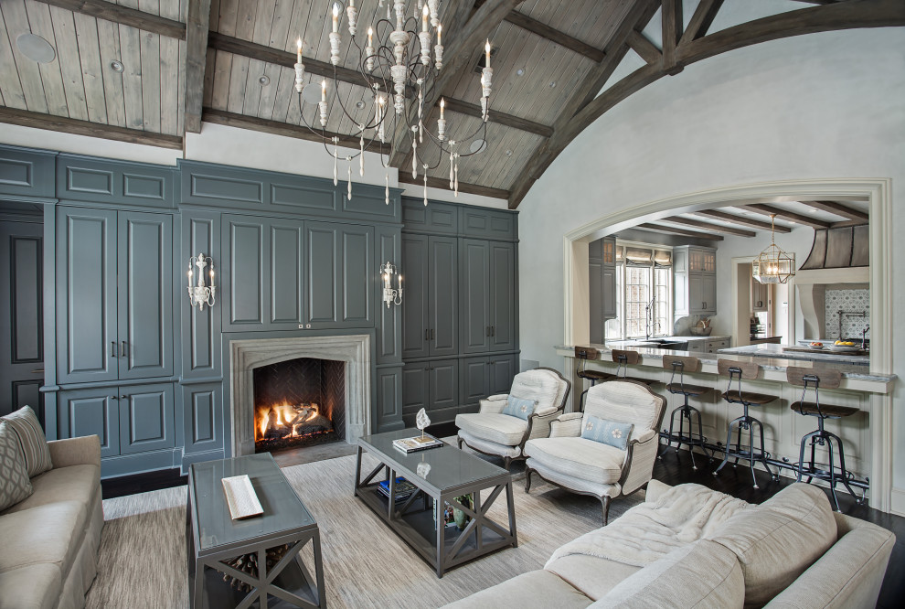 Living room - mid-sized traditional open concept dark wood floor and black floor living room idea in Houston with gray walls, a standard fireplace, a stone fireplace and a concealed tv