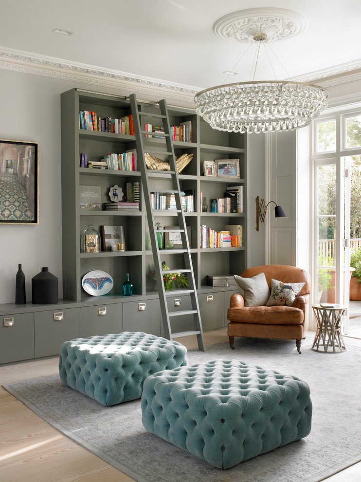 Inspiration for a large transitional open concept light wood floor and beige floor living room library remodel in London with gray walls, a standard fireplace and a stone fireplace