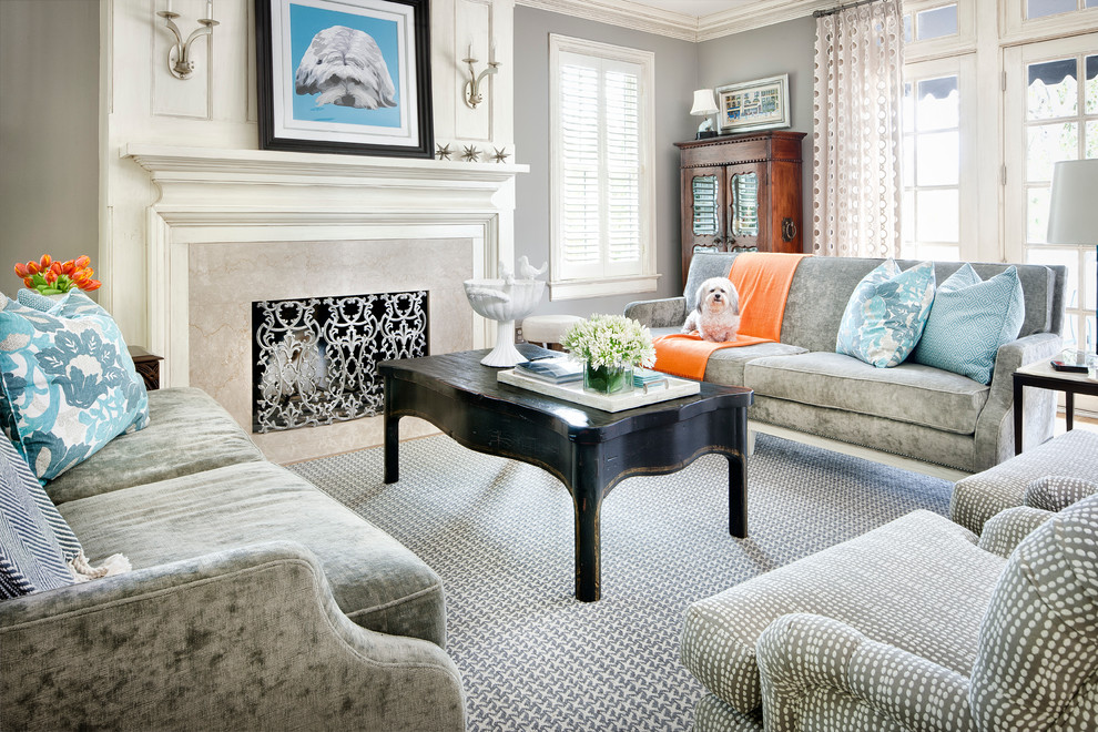 Inspiration for a transitional medium tone wood floor living room remodel in Minneapolis with gray walls, a standard fireplace and a stone fireplace