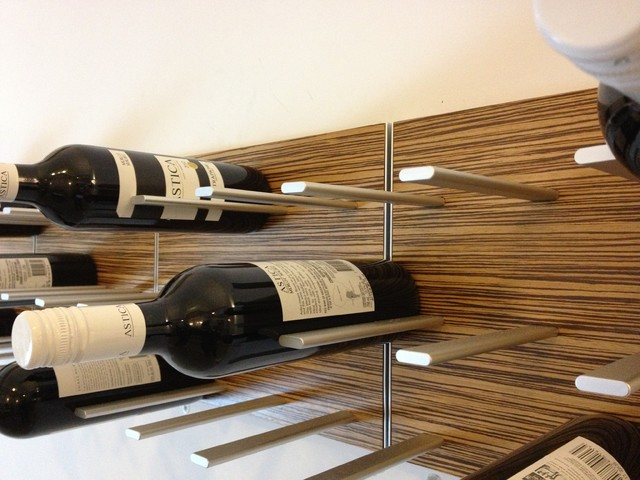 Wine Displayed as Wall Art - STACT Modular Wall-mounted Wine Rack modern-living-room